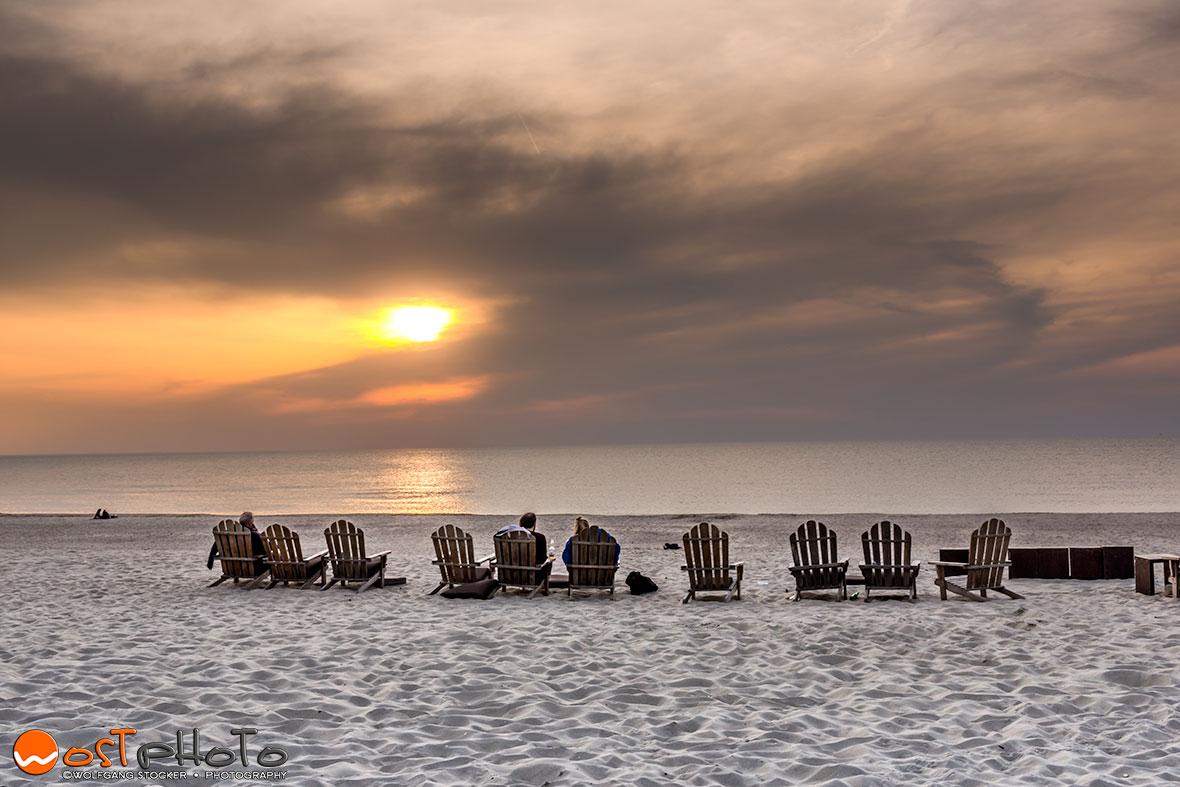 Watching the  sunset in the sand dunes of Scheveningen/The Hague in the Netherlands